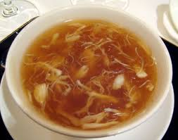 Shark Fin Soup. It has white sperm-shaped pieces in thick, dark yellow broth.
